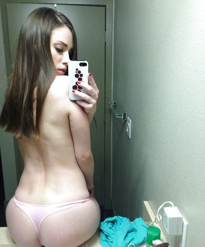 Hot amateur pictures herself as she strips down and teases her pussy