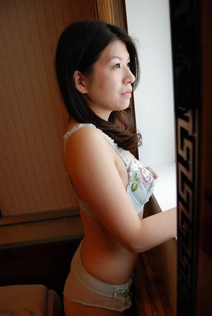 Asian MILF undressing and spreading her hairy lower lips in close up
