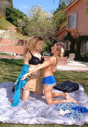 Frisky tattooed teen has some lesbian fun with her mature friend outdoor