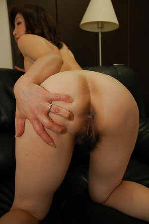 Asian MILF in dress clothes undressing and spreading her lower lips