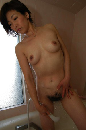 Asian MILF Setsuko Miwa taking shower and exposing her fuckable body