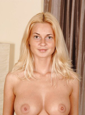 Well-stacked smiley blonde undressing and exposing her trimmed cooter