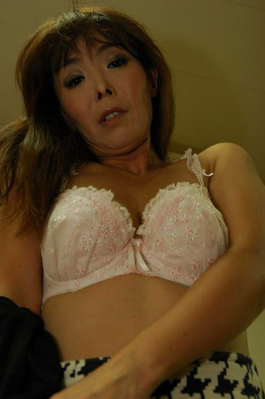 Naughty asian MILF Kayo Mukai undressing and posing nude on the bed