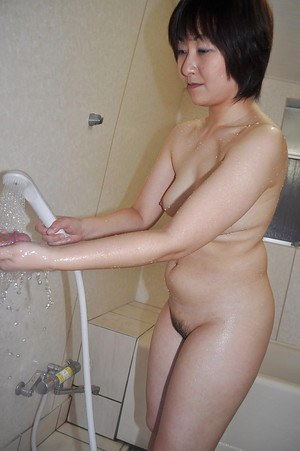 Asian MILF with ample ass and hairy gash Masae Shimatani taking shower