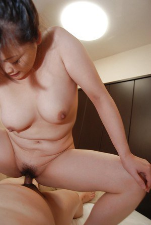 Slutty asian MILF Chisako Nimura gives a blow and titjob and gets fucked