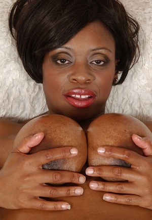 Oiled up ebony lassie with round jugs toying her pussy and pissing