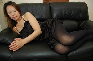 Asian MILF Maki Shimazaki undressing and demonstrating her cunt in close up