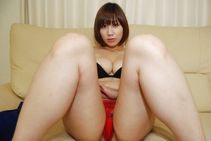 Busty asian cutie with shaggy cunt undressing and spreading her legs