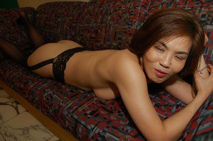 Asian lady Chika Ohara gets rid of her clothes and poses in sexy stockings