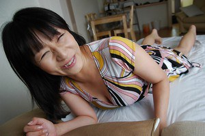 Asian babe Yukie Minagawa undressing and exposing her pussy in close up