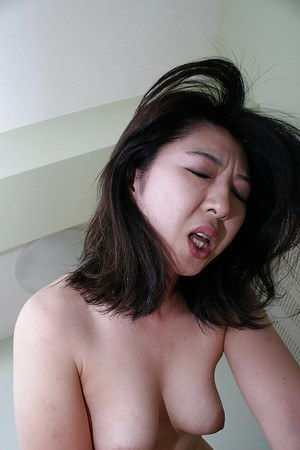 Asian MILF Naho Tajiri gets her unshaven cunt cocked up and creampied