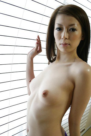 Asian babe Mai Katagiri undressing and exposing her seductive curves