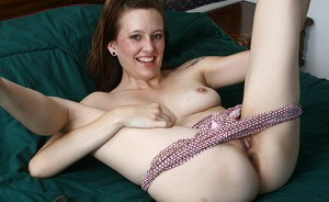 Naughty mature lady undressing and stuffing her twat with a vibrator