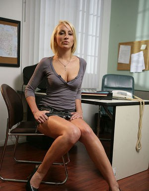 Stunning blonde with long legs stripping down at her office work place