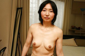 Shy asian MILF in pantyhose Junko Konno getting rid of her clothes