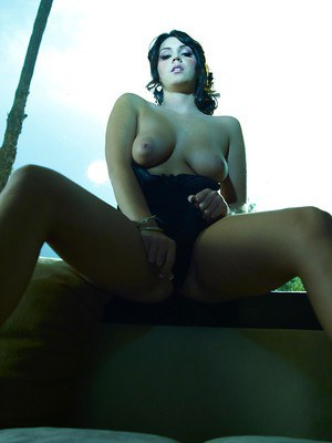 Foxy babe Alison Tyler revealing her ample bosoms and teasing her gash