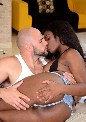 Bootylicious ebony sweetie fucks a white boner and gets her smiley face jizzed