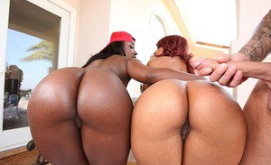 Naughty ebony chicks with round booties have a threesome with a white lad