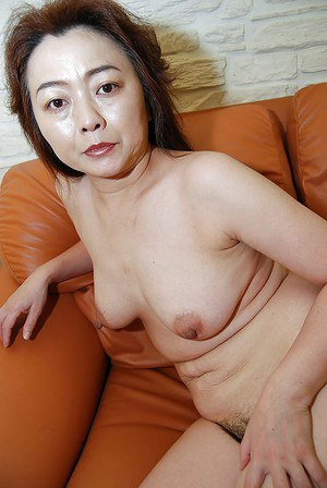 Mature asian gal undressing and spreading her lower lips in close up