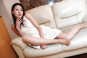 Foxy asian MILF Satomi Endou getting rid of her dress and lingerie