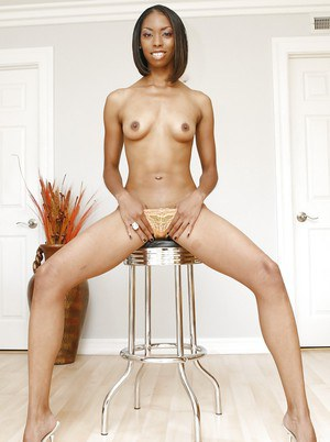 Skinny ebony doxy with shaved cunt gets fucked and jizzed over her fanny