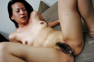 Hiroko Ebihara gets her hairy pussy creampied after hardcore sex play