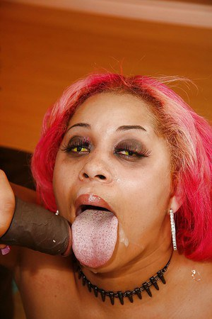 Pink-haired ebony plumper in fishnet pantyhose fucks and blows off a huge cock