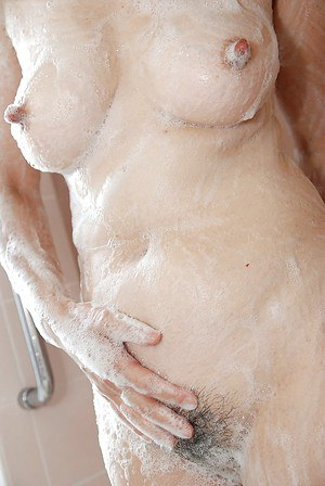 Asian MILF Kimie Kuwata exposes her goods in close up while taking shower