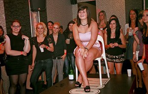 Lascivious amateurs going down on stiff cocks at the party with male strippers