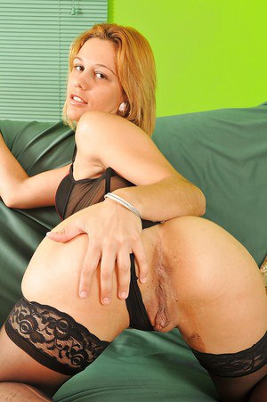 Latina lassie in lingerie and stockings revealing her inviting holes