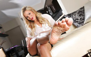 Smiley blonde MILF revealing her sexy curves and sweet soles