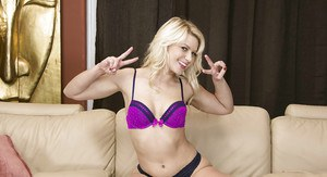 Raunchy blonde babe Anikka Albrite getting rid of her clothes