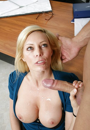 Lewd teacher Holly Sampson seduces her student and plays with his big cock