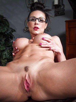 Tempting MILF in glasses Kendra Lust undressing and spreading her legs