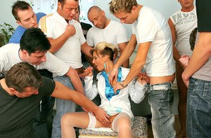 Lewd gal gets jizzed all over her face after clothed gangbang action