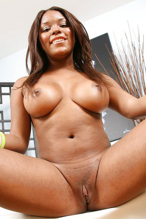 Ebony lady Candice Nicole uncovering her hot curves and spreading her legs