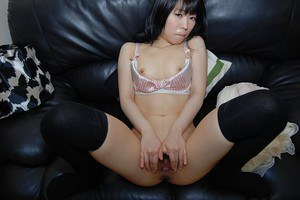 Steamy asian babe taking off her panties and exposing her pussy in close up