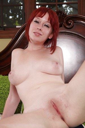Sassy redhead with big tits and shaved gash undressing and spreading her legs