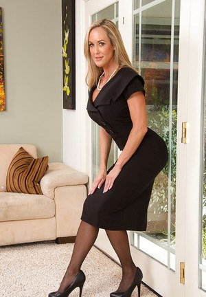 Gorgeous blonde cougar in stockings undressing and exposing her goods