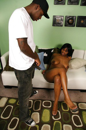 Slutty ebony gal blows and fucks a black boner for cum on her mouth