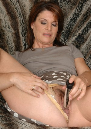 Salacious mature lady pleasing her hungry twat with two vibrators
