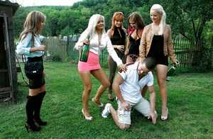 Lusty european sluts have some fully clothed pissing fun with a inky lad
