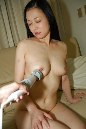 Sassy asian chick gets her hairy cooter pleased with a vibrator