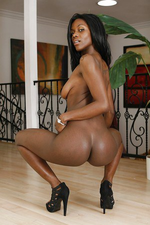 Smiley ebony lassie with svelte curves slipping off her sexy lingerie