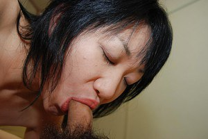 Asian chick with saggy tits gives head and gets her shaved cunt plugged tough