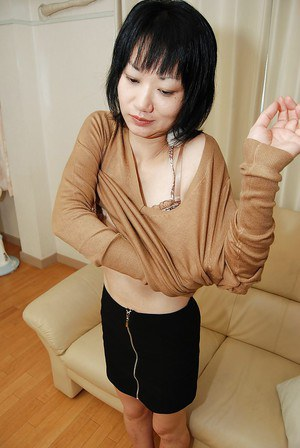 Shy asian MILF strips down and gets her shaved twat stuffed with a toy