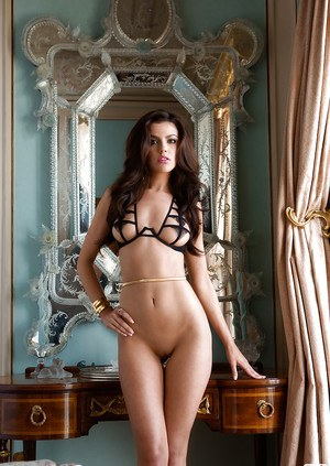 Immensely pretty  brunette with shaved cooter showcasing her slender curves