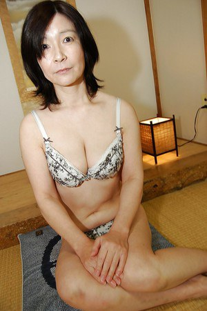 Naughty asian mature lassie getting nude and exposing her shaggy gash
