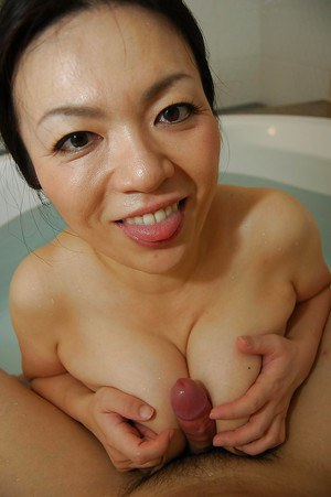Saucy asian MILF gives a sensual tit and blowjob in the bath