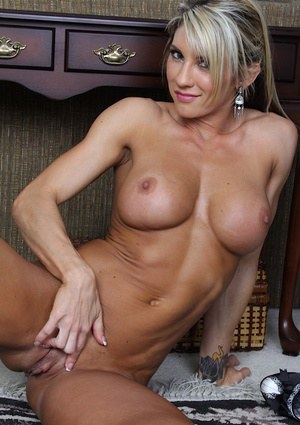 Well-toned MILF with big round tits undressing and spreading her hot legs